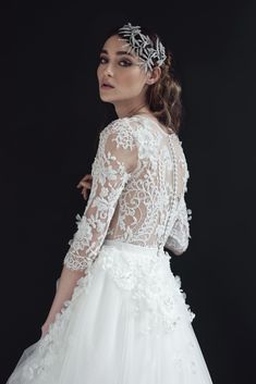 Hand embroidered #Solstiss lace gown with seed beads, #Swarovski crystals and pearls. Soft Italian tulle skirt, with cut out lace and handmade flowers applique.