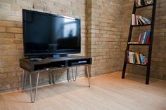TV Stand, with just the right amount of storage. Perfect for the tighter condo spaces.
