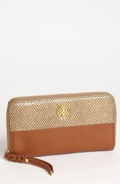 My two favorites, leather and embossed python. Tory Burch Continental Wallet.