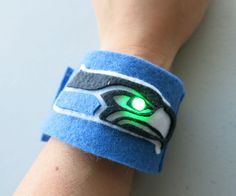 I'm in! Sew your own LED Seahawks bracelet and wear it for the Super Bowl! Your bracelet will light up when you snap it together and close the circuit.