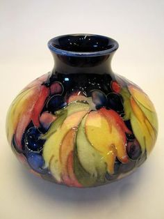 A William Moorcroft 'Leaf and Grape' pattern vase Circa 1930