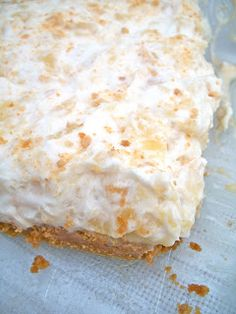 "Pineapple Delight Dessert...""If you're a pineapple lover like me then you'll love this dessert. The combination of the graham cracker crust, the creamy buttery filling, and the fluffy, pineapple-studded whipped cream is seriously amazing. I remember my grandma and my mom making this all the time growing up""..."