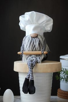 Calling all bakers , cooks and barbecue masters! This little guy is for you! Style: Kitchen Gnome with Legs + Wooden Rolling Pin Size: 14 from top of the head to the bottom of the boots. when sitting he is about 8 tall. Color: Black Body, Gray Beard , White Cotton Chef hat. Each gnome is