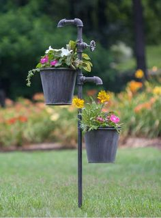 "Give your garden an industrial look with this clever little planter. The spigots give the appearance of the running water to the flowers below. It stands 40½"" tall and 15"" spread from plant holder to"
