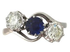 'Sapphire & Diamond Three Stone Ring' http://www.acsilver.co.uk/shop/pc/0-70-ct-Sapphire-and-0-75-ct-Diamond-18-ct-Yellow-Gold-Trilogy-Ring-Vintage-Circa-1950-35p8635.htm