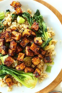 BAKED NOT FRIED crispy tofu in a 5-ingredient peanut glaze! So delicious especially over cauliflower fried rice!!
