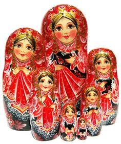 One-of-a-kind Czarevna 7 piece nesting doll in a traditional black and red Russian costume dress. Exclusive babushka is hand painted. Free shipping.