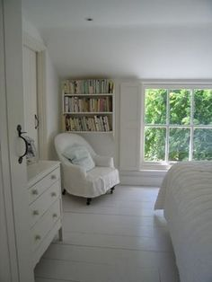 Attic bedroom; love the reading corner and big floor level window