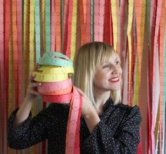 cute diy idea for a photobooth backdrop - colorful streams of unwound rolls of carnival tickets. #livebetterorganized
