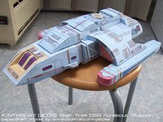 """Star Trek DS9 papercraft   Runabout by ninjatoespapercraft NCC-72936 runabout """"Rubicon"""" was the runabout that got shrunk to just about 4 inches in the Star Trek Deep Space Nine episode """"One Little Ship"""". My papercraft version is about 16.5 inches big, though; it's actually still one of the biggest papercraft models I made so far!  Like all my early papercraft models, I drew all the parts by hand and coloured them in aquarel, which gives it a really nice look I think.          - by designer"""