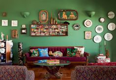 living room---i love lots of things on the walls. i think it is interesting and makes me feel at home