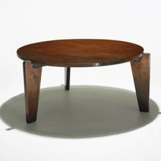 Jean Prouvé Guéridon Bas coffee table    Ateliers Jean ProuvéFrance , c. 1942/1952 oak, enameled steel. v20 Tree Trunk Coffee Table, Coffee Table Desk, Jean Prouve, Bauhaus, Simple Style, Decorative Items, Cool Things To Buy, Living Spaces, Furniture Design
