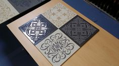A selection of square designs engraved into Porcelain tiles