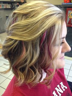 Long bob with curls. Pink peek a boo highlights. Salon A Go-Go