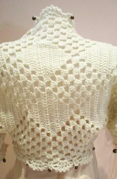 """You might find crochet shrug patterns including terms such as """"bolero,"""" """"cropped jacket"""" or """"cropped sweater."""" I've even seen a classic crochet shrug pattern from the"""