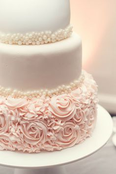 Pretty pearl detailing on this traditional wedding cake.