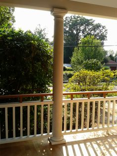 Another WJM porch railing for a home that reflects historic character - Porch railing with double top rail, one white, one dark, to visually lower the height of the railing