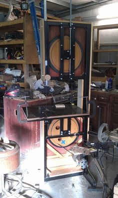 "18"" Bandsaw by mr95gst -- Hello All, My name is Matthew and last year I made an 18"" band saw from a treadmill, wood, steel, aluminum, and whatever else I could find laying around. I had been using an angle grinder to do my metal cutting. I finally got fed up with the shavings it through all over me and the shop and decided I needed a band saw. I couldn't afford the saw I wanted so I decided to try and make one.The motor is 2.5hp 90v dc and came from a treadmill. The wheels are made from…"