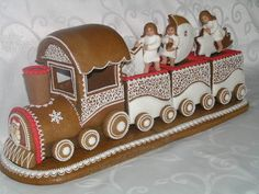 Topperland specialises in making Toppers for celebration cakes as well as ornamental figurines. Topperland specialises in making Toppers for celebration cakes as well as ornamental figurines. Gingerbread Train, Gingerbread Village, Gingerbread Decorations, Christmas Gingerbread House, Noel Christmas, Christmas Baking, Gingerbread Cookies, Christmas Cookies, Christmas Crafts