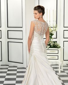 Wedding dress in Satin, with a beaded embroidered lace back, I love the back!!
