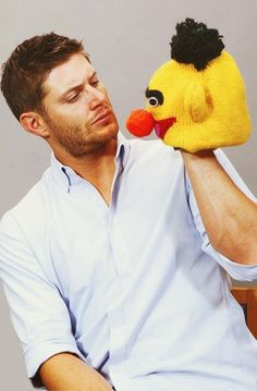 Jensen Ackles is handsome even when he's holding a hat from Bert's head