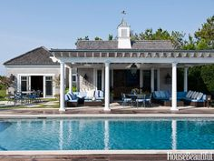 In a Southampton house, designers Kim Coleman and Michele Green added blue cushions on the Janus et Cie poolside furniture to match the clear blue sky.