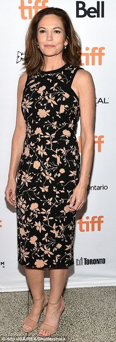 She looked toned and trim in a sleeveless floral dress that had a black background and light pink flowers