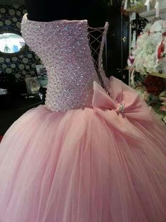BEAUTIFUL light pink Quince dress! With a big pink bow in the back to finish it off!