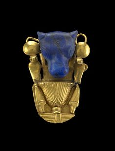Lapis-lazuli Bull's Head -- Likely of Mesopotamian origin, set into a gold mount of Egyptian workmanship with floral decoration. Belonging to The British Museum