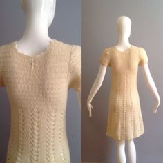 Such a Cute Vintage Crochet Dress  Made from Cream Wool  A Line Cut  Slight Open Weave Knit  Tiny Pearl Button Closure at Nape of Neck  Excellent Vintage condition  With dress lying flat, in inches:  **Fabric Stretches**  Shoulders: 14 Underarms: 16 Waist: 13.5 Hips: 19 Total Length: 38
