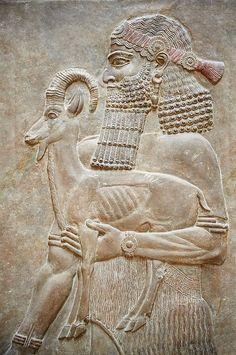 Stone relief sculptured panel of a man holding an Ibex and a poppy flower ,#Assyrian King Sargon II. 706 B.C #Louvre Musée du Louvre (@MuseeLouvre) | Twitter
