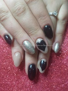 Black and nude gel polish with freehand heart nail art
