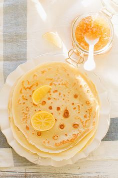 Lemon Honey Pancakes by marthastewart: These delicate filled crepes get their mild sweetness from honey, their tang from fromage blanc, and their tartness from a little lemon zest and juice. #pancakes #lemon #honey