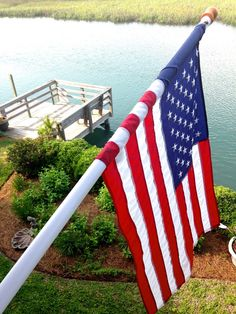 American flag by the dock, lake house