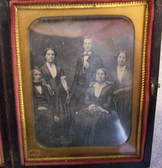1840's Daguerreotype 1/4 Plate Double Photograph Family Photo. Classic early daguerreotype family photo~~I'm assuming the family was to large for one photo. Double-eliptical mat and simple sturdy preserver, full case with separating hinge.