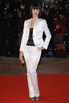 Katy Perry Pantsuit - Katy Perry showed off a distinctly different look in a white satin suit at the NRJ Music Awards.