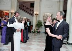 Unseen: The pictures have emerged as part of a Channel 4 documentary about the Princess. Diana is seen here taking to the floor with Clint Eastwood (right), while Prince Charles dances with another woman (far left). Princess Diana,  24 yrs old, looking uncomfortable in the arms of Dirty Harry.  Tom Selleck dancing with First Lady Nancy Reagan.