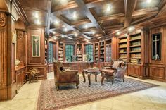 The library room is heavy oak wood, with subtle lighting installed in the paneled ceilings. Family Room, Home And Family, Double Staircase, For Rent By Owner, Sauna Room, Rich Home, Pool Waterfall, Piano Room, Indoor Swimming Pools