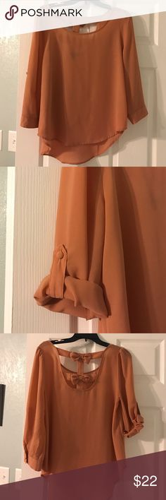 Peach colored bow embellished blouse Peach colored bow embellished blouse. Brand mine. Size medium. Sleeves can be rolled. Rolled down still three quarter sleeved. mine Tops Blouses