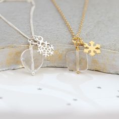 A gorgeous faceted crystal pendant necklace with a sterling silver or  gold snowflake charm. Add an initial charm to create the perfect  Christmas present or gift for a winter wedding.
