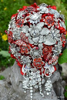 Red rose garden cascading brooch bouquet