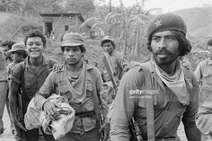 Sandinista militants gather together inside a village under Sandinista control near the Honduras border. The Sandinistas came to power in 1979 after forcing Antonio Somoza from office.