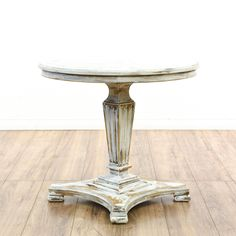 """This """"Drexel Heritage"""" end table is featured in a solid wood with a distressed white chalk paint finish. This shabby chic side table has a round table top with a carved pedestal base and fluted details. Great for the side of an armchair!  #shabbychic #tables #endtable #sandiegovintage #vintagefurniture"""