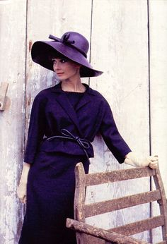 Audrey Hepburn in purple by the park bench
