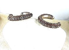 Antique Yemen silver bracelets with granulation covering the visible surface with rosettes and diamond design.  The braided wire motif is also typical in Yemeni pieces of this age.       A significant