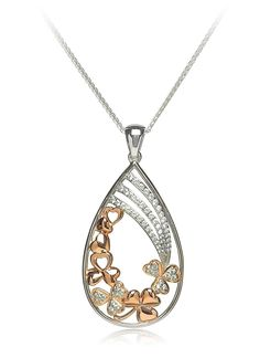 Intricate and unique, this beautiful Sterling Silver and Rose Gold Plated pendant incorporates traditional Irish shamrocks and hearts with the added detail of cubic zirconia.