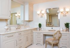 Separated his-and-her vanities were musts for this bathroom renovation. The end result was two complementary vanities with an enlarged vanity for her, featuring a beauty station.