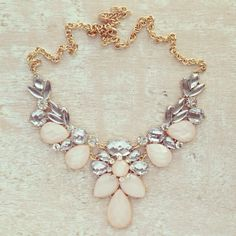 Statement necklace in soft shades .