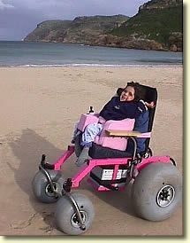 This little girl is enjoying the beach thanks to human inventiveness.