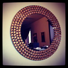 DIY decorated mirror made with dollar store flat stones